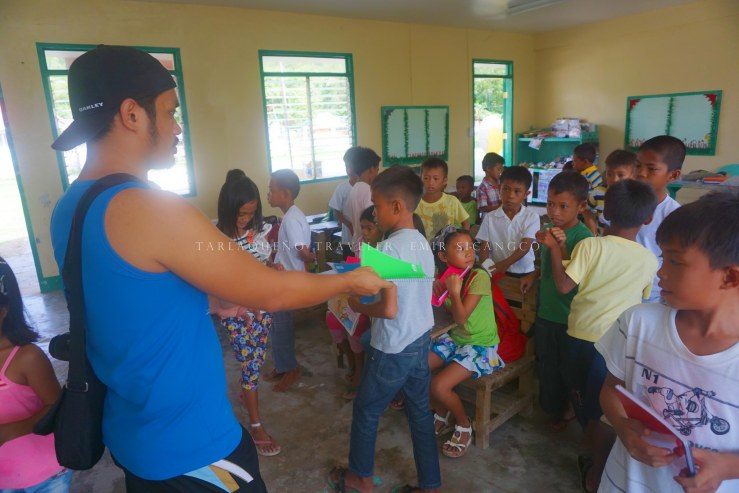 My friend Jayson distributes school supplies to the pupils