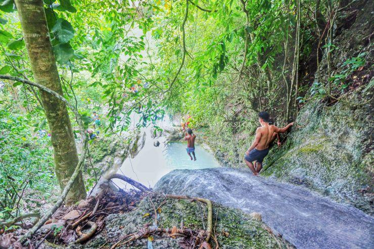 Experience one adrenaline-pumping cliff jump in Kawa-kawa Falls